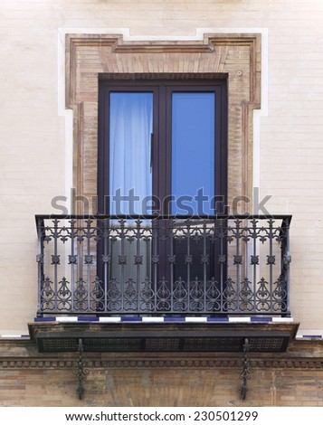 Decorative balcony of a house in Seville, Spain - stock photo