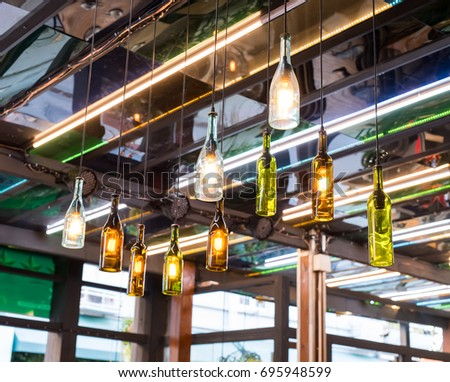 Decorative beer bottle style diode light bulb hang from ceiling