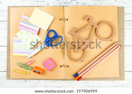 Decorative bicycle with needlework composition on book close up - stock photo