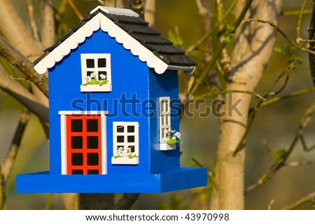 Decorative Bird House in Tree - stock photo