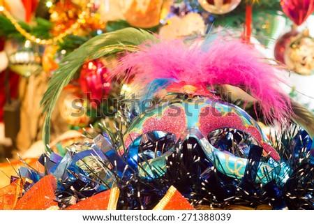 Decorative blue Christmas mask with holiday decorations background. - stock photo