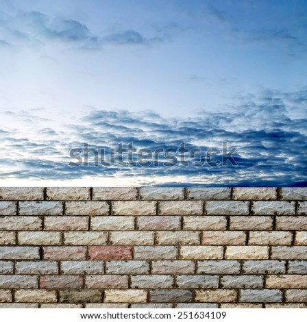 decorative  brick fence wall against blue sky