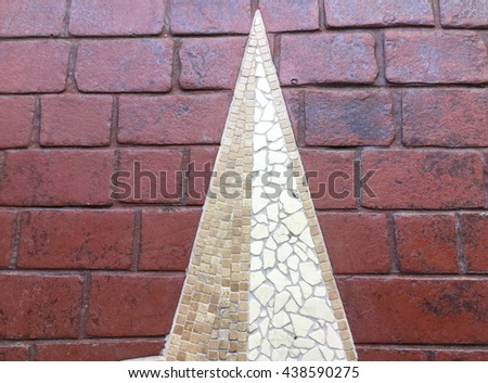 Decorative Brown and white mosaic on red brick background. - stock photo