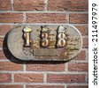decorative but weathered house number one hundred and thirty eight. - stock photo