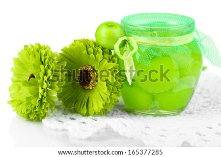 Decorative candle in form of apple jam with flowers isolated on white - stock photo
