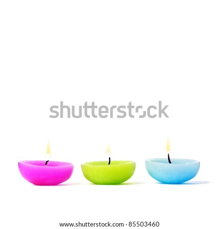 Decorative candles with essential oils, for aromatherapy. - stock photo