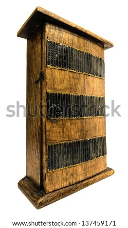 Decorative carved wooden cupboard on a white background - stock photo