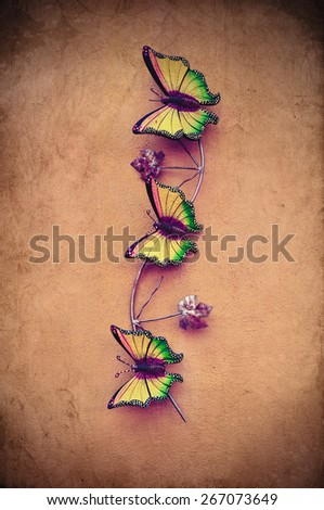 Decorative ceramic butterfly on vintage grunge texture wall  - stock photo