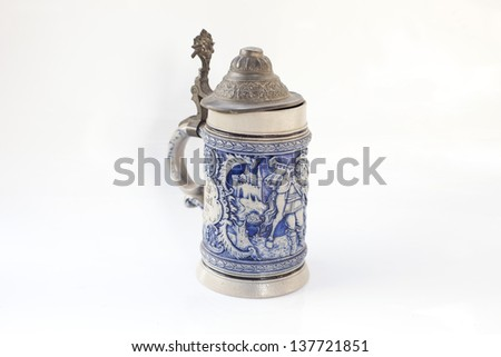 Decorative ceramic old German beer stein isolated on white - stock photo