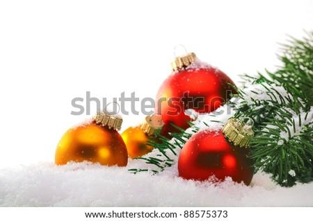Decorative Christmas balls and Christmas tree on the snow. - stock photo