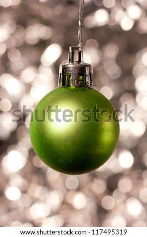 Decorative Christmas ornament on sparkly background