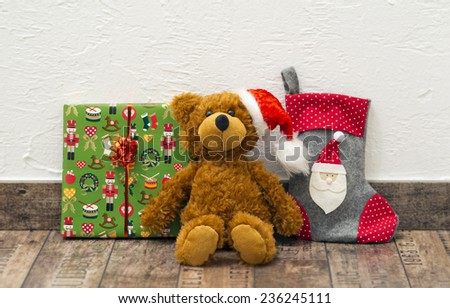 decorative christmas presents (teddy bear with santa hat, boxed gift and stocking) - stock photo