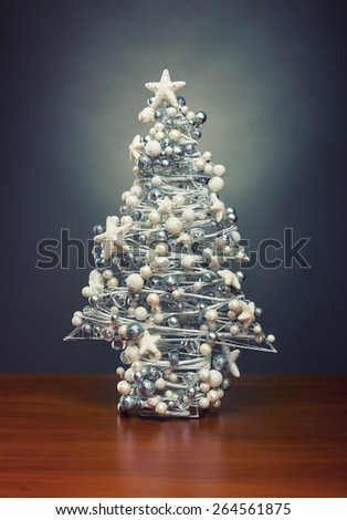 Decorative christmas tree on wooden table - stock photo