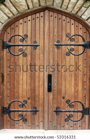 Decorative church door with iron hinges