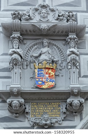 decorative coat of arms at the old town hall of Celle, Germany - stock photo