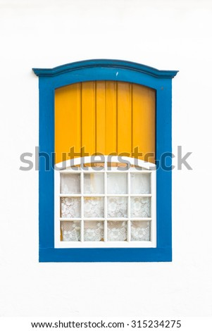 Decorative, colonial, blue, vintage, window on a white wall in Paraty or Parati, Brazil. - stock photo