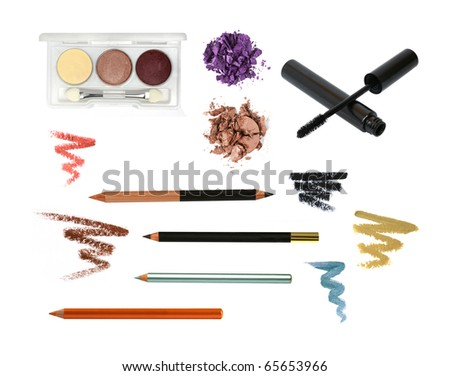Decorative cosmetic products for eye makeup isolated on white. Pencil, eyeshadow, palette, strokes, crushed eyeshadow. - stock photo