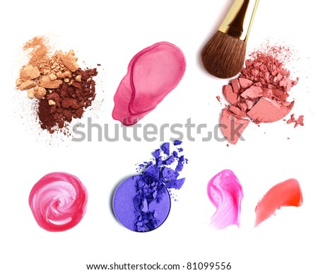 Decorative cosmetic samples isolated on white. Lipstick, lip gloss, eyeshadow, spilling. - stock photo