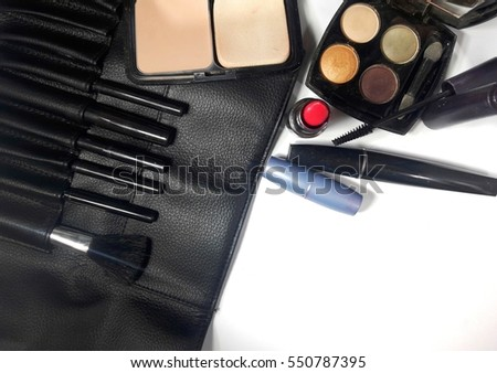 Decorative cosmetics and accessories on white background. Flat lay. Copy space.