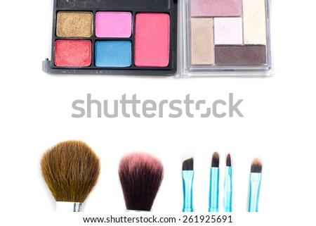 Decorative cosmetics isolated over white background - stock photo