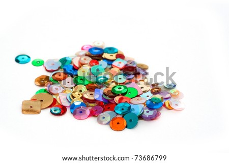 decorative craft sequins on a white background - stock photo