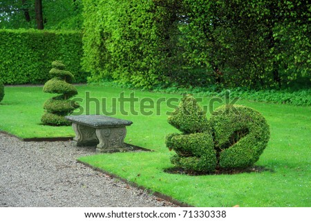 decorative cut of bushes in a park - stock photo