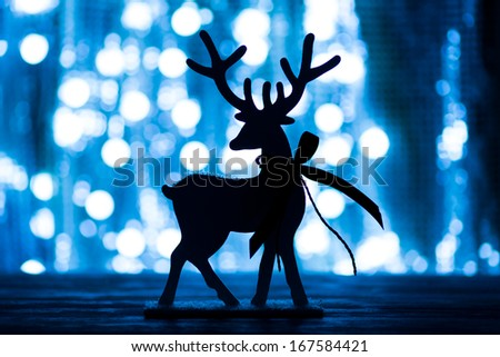 Decorative deer, a Christmas background. New Year greeting card  - stock photo