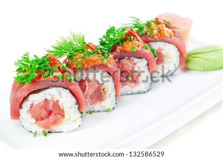 Decorative dish sushi rice salmon raw meat and spices closeup.
