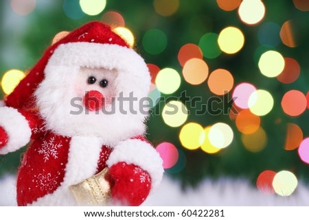 Decorative doll of a Santa Claus on festive background - stock photo