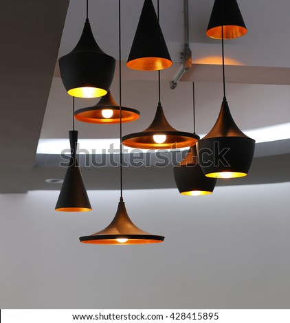 Decorative electric lamps hanging on the ceiling - stock photo