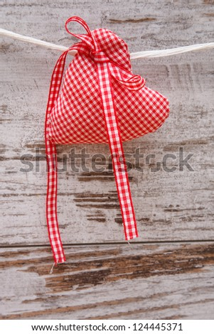 decorative fabric heart for Valentines day - stock photo
