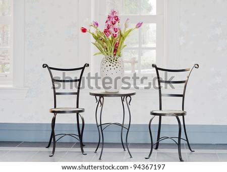 decorative flower on table ,room interior - stock photo