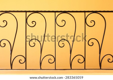 Decorative, forged banisters, fence in old stile. - stock photo