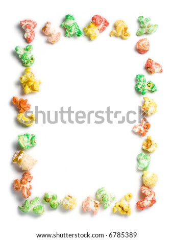 decorative frame made of colored popcorn in green, red, orange, yellow, white background with copyspace