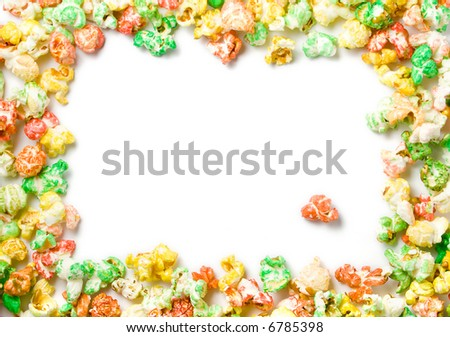 decorative full border made of colored popcorn in green, red, orange, yellow, white background with copyspace