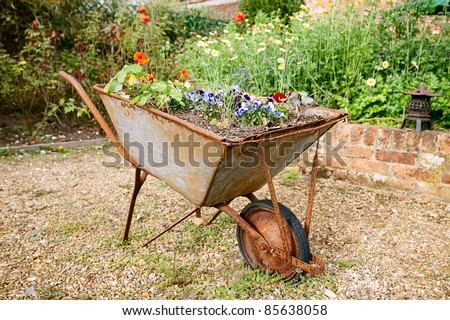 decorative garden wheelbarrow with flowers