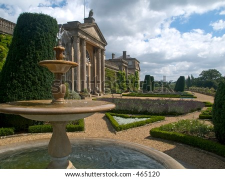 Decorative gardens with a fountain - stock photo