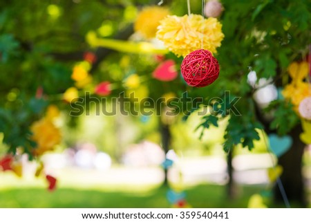 Decorative garland includes pompons and rattan balls outdoor - stock photo