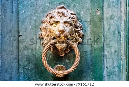 Decorative gilded lion head door knob - stock photo