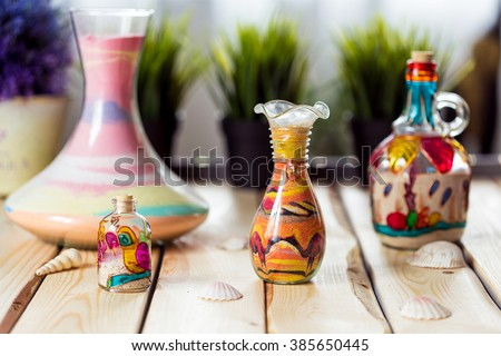 Decorative Glass Bottles with Colored Sand Inside and Shapes of Desert and Camels - stock photo