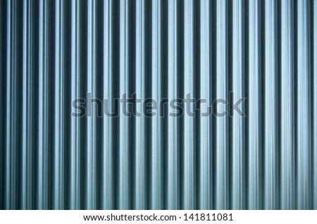 Decorative glass of parallel vertical lines texture - stock photo