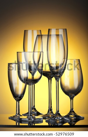 decorative glasses on a yellow background