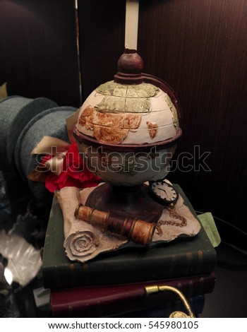 decorative globe and books