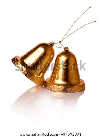 decorative gold holiday bells carved on a white background - stock photo