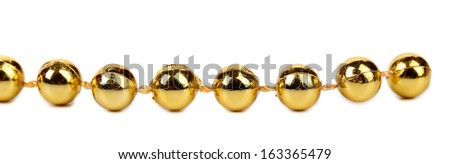 Decorative golden beads. Horisontal. Isolated on a white background.