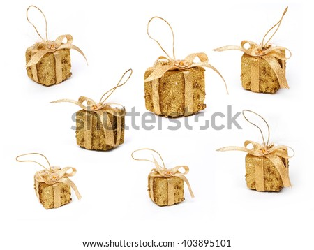 Decorative golden Christmas tree presents isolated on a white background.