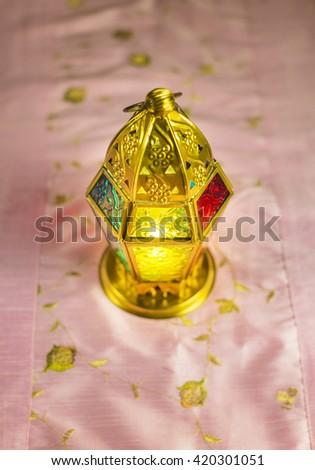 Decorative golden Ramadan lamp- top angle. - stock photo
