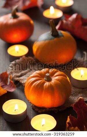 decorative halloween autumn pumpkins and candles - stock photo