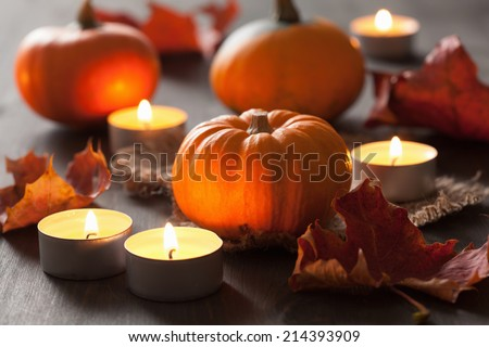 decorative halloween pumpkins and candles  - stock photo