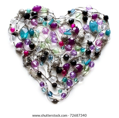 Decorative heart from jewelry a beads on white background - stock photo